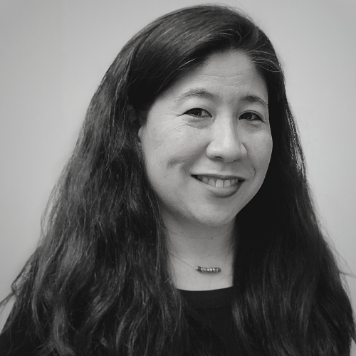 [Black and white image of Asian woman with long hair down]
